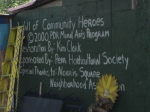A sign detailing the creation of the community leaders mural
