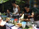 Youth leaders setting out guacamole and salsa for the community