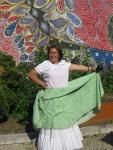 Maribel Lozada in front of a mural in El Batey