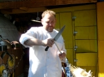 Chef Nat sharpening his knives for Napoleon, the roasted pig.