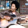 Alex Cuba with guitar