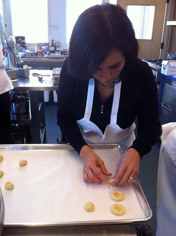 Maria making Brazilian thumbprint cookies