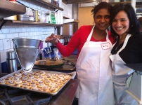 Jenny and Maria adding powdered sugar to the thumbprint cookies